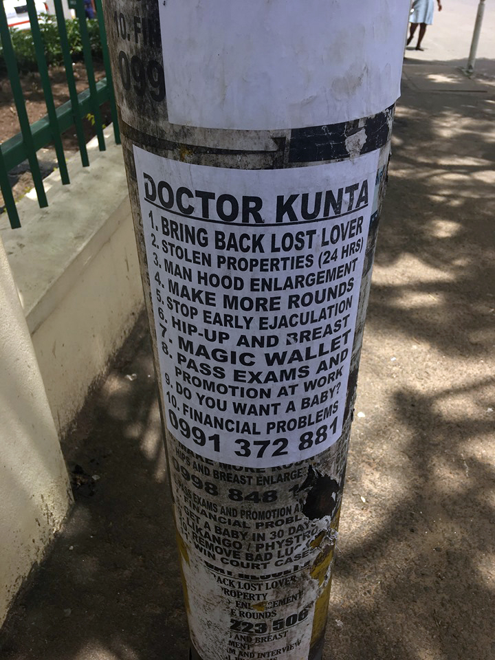Poster advertising the services of Dr Kunta, a witch-doctor offering 'medical' and financial help.