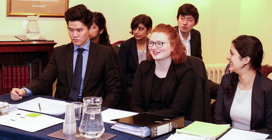 (L-R) Gilbert Lim (Christ Church), Niamh Kelly (Merton), and Shalaka Phadnis (St Peters) mooting in the national Jessup rounds