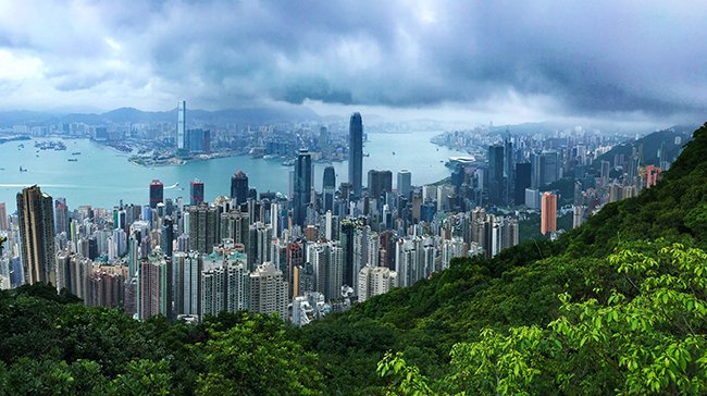 A panorama overlooking the Central and Kowloon districts of Hong Kong, taken from Victoria Peak - Photo: © Henry Grub