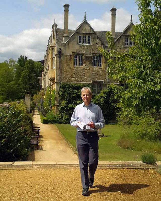 Professor Steven Gunn walking 12.64 times round the College garden while reading a book about Queen Elizabeth I