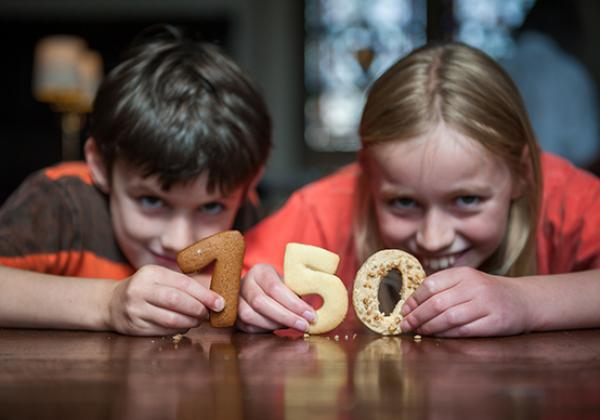 Two children with pastry numbers - Photo: © John Cairns - www.johncairns.co.uk
