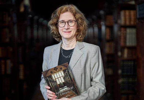 Dr Julia Walworth with a copy of her new book, a history of Merton College Library, in the Upper Library - Photo: © Ian Wallman - www.ianwallman.com