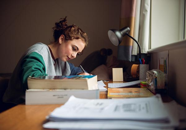 A student preparing for a tutorial in her room - Photo © John Cairns - www.johncairns.co.uk