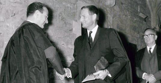 Rex Richards (right) in 1969, being welcomed to the college by John Roberts (then a Fellow in History)
