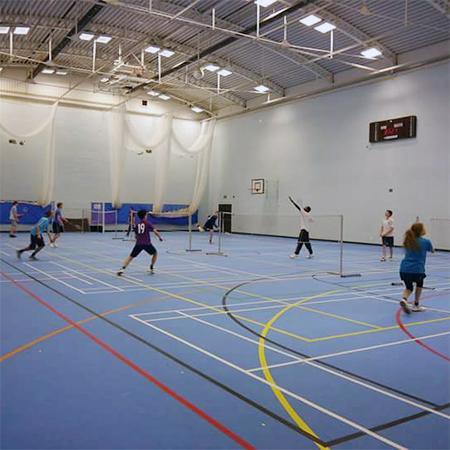 Badminton courts with games in action