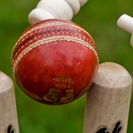 A cricket ball hits a wicket - Photo: © Graham Dean, used under CC BY 2.0 licence
