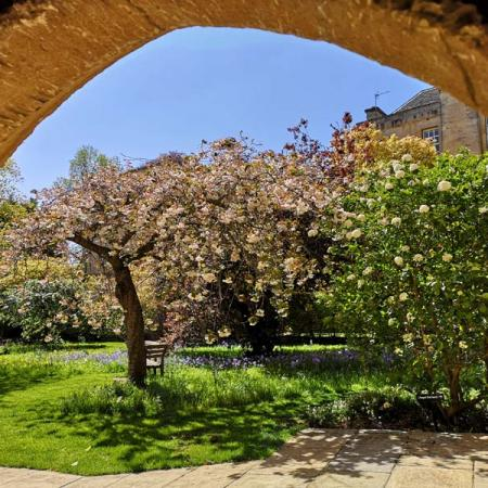 View from an archway to the Merton Chapel garden
